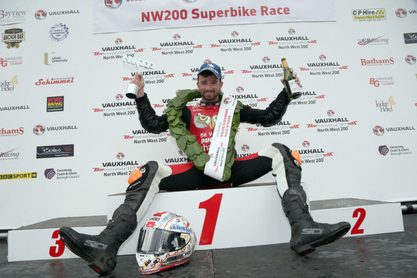 PACEMAKER BELFAST  13/05/2016 Glenn Irwin celebrates victory in the Superbike North West 200 feature race at todays Vauxhall International North West 200. Photo Stephen Davison/Pacemaker Press